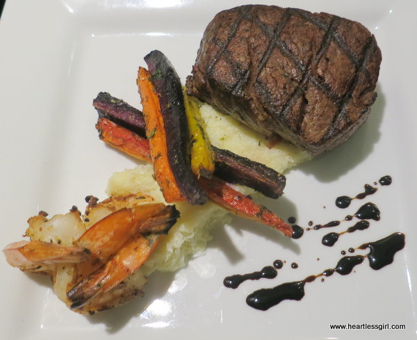 Grilled beef tenderloin and butter poached jumbo prawn with cauliflower mash, heirloom carrots and horseradish reduction.
