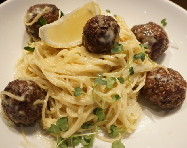 Hat Trick Turkey Meatballs with spaghetti in a manchego cream sauce with italian style meatballs & fresh lemon.