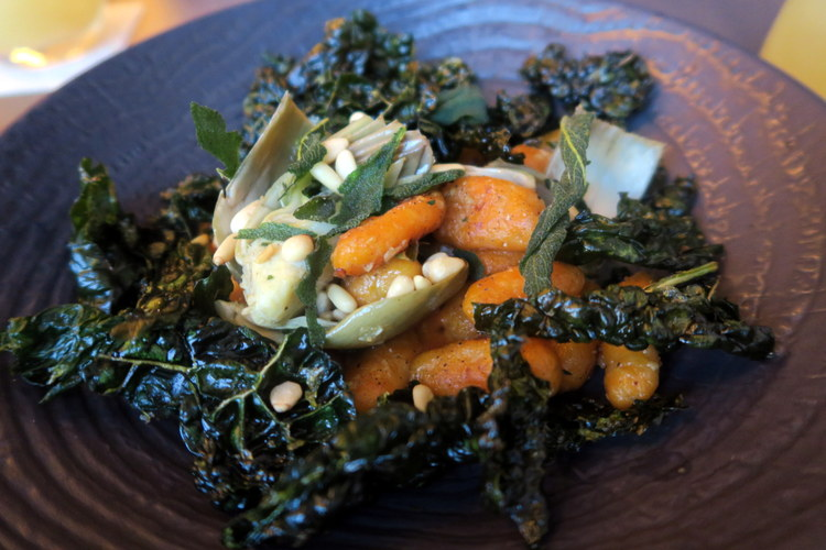 House made butternut squash gnocchi served with fried kale and sage chips, dusted with pine nuts.