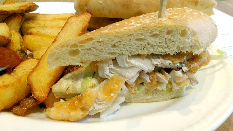 Fried haddock sandwich, tartar sauce and house fries